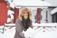Smiling girl with snow in the hands Royalty Free Stock Images