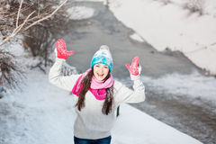 Smiling girl on snow winter background Royalty Free Stock Photo