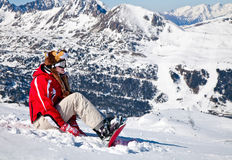 Smiling girl snowboarder. In the mountains Stock Photography