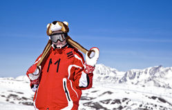 Smiling girl snowboarder. In the mountains Royalty Free Stock Photos