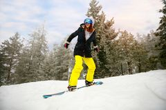 Girl snowboarder in jump at ski resort in the mountain- winter e Stock Image