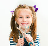 Smiling girl with spanners Stock Photography