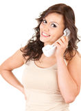 Smiling girl speaking on the phone. White background Stock Image