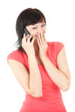 Smiling girl speaking on the phone. White background Royalty Free Stock Photography