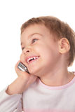 Smiling girl speaks on cell phone Royalty Free Stock Photo