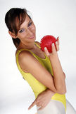 Smiling Girl with Spike Ball. A Girl holding a spike Ball in the white fitness studio stock photo