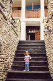 Smiling Girl on Stairs Royalty Free Stock Image