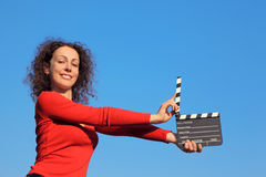 Smiling girl standing with clapperboard Stock Images