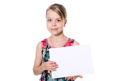 Smiling girl standing with empty blank paper in hands Stock Image
