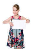 Smiling girl standing with empty blank paper in hands Royalty Free Stock Photos