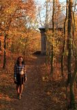 Smiling girl standing in forest. Smiling pretty girl - young Papuan woman standing on forest path to Arbor above Zbraslav during sunset in Prague, Czech Republic Stock Image