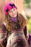 Smiling girl standing near the column at the park Stock Photo