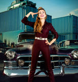 Smiling girl standing near retro car Stock Images