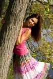 Smiling girl standing near tree Royalty Free Stock Photos