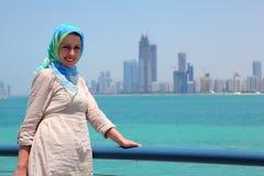 Smiling girl standing on ship against skyline Stock Photography