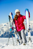 Smiling girl standing with ski. Royalty Free Stock Photo