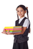 Smiling girl standing with stack of books Royalty Free Stock Photography