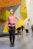 The smiling girl stands  with climbing equipment Royalty Free Stock Photography