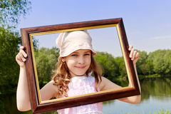 Smiling girl stands outdoors Royalty Free Stock Image