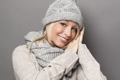 Smiling girl staying warm in wrapped up soft winter clothing Royalty Free Stock Image