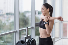 Smiling girl stretching her arms after training Stock Images