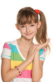 Smiling girl in a striped blouse Royalty Free Stock Image