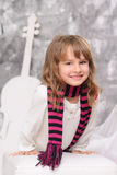 Smiling girl with striped scarf indoors Royalty Free Stock Photo