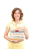 Smiling girl with stuck of books over white Royalty Free Stock Photo