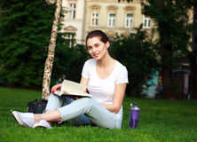 Smiling girl student in city park with book Stock Photography