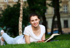Smiling girl student in city park with book Stock Images