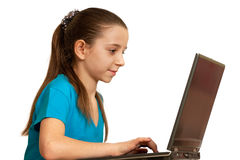 Smiling girl studying with the laptop. A smiling girl is working on the laptop; isolated on the white background royalty free stock images
