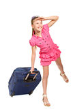 Smiling girl with a suitcase looks into the distance Royalty Free Stock Photos