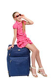 Smiling girl with suitcase and sunglasses Royalty Free Stock Images