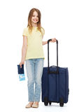 Smiling girl with suitcase, ticket and passport Royalty Free Stock Photos