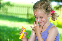 Smiling girl with suncream Royalty Free Stock Photo