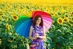Smiling girl in the sunflower fields Royalty Free Stock Photos