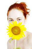 Smiling girl with a sunflower in the hands Stock Photos