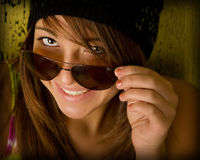 Smiling girl with sunglasses. Young teenage girl looking at camera Royalty Free Stock Photography