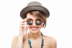 Smiling girl in sunglasses and hat. Funny summer portrait of beautiful smiling girl in sunglasses and hat, looking at camera Royalty Free Stock Images