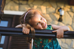 Smiling Girl in Sunset Light. At wooden fence Royalty Free Stock Images