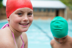Smiling girl with swim cap near poolside Royalty Free Stock Photography
