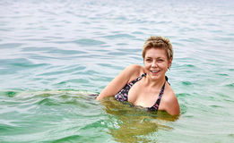 Smiling girl swiming in the sea Stock Image