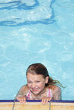 Smiling girl in swimming pool Royalty Free Stock Photography