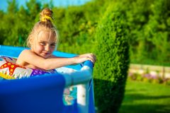 Smiling Girl in a Swimming Pool Royalty Free Stock Photos