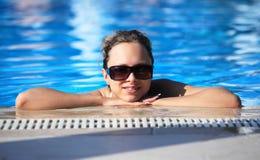 Smiling girl in swimming pool. Resort stock image