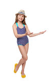 Smiling girl in swimsuit showing open hand palm Stock Photography