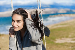 Smiling girl on a swing Royalty Free Stock Image