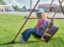 Smiling girl on swing Stock Image