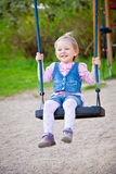 Smiling Girl Swinging Royalty Free Stock Photography