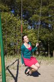Smiling girl swings on the sunny beach Royalty Free Stock Photos
